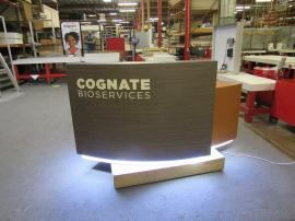Custom Reception Desk with ToeKick Accent Lights, Locking Storage, Wire Management, Shelves, and Graphics